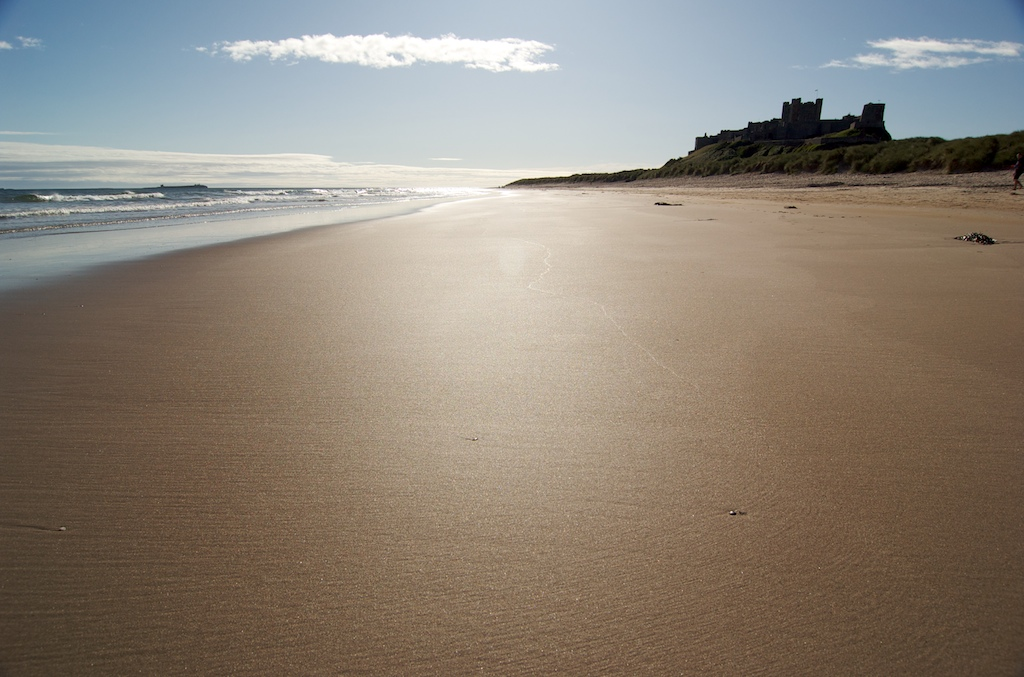 Bamburgh Beach bathed in morning sunlight